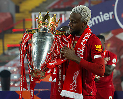 LIVERPOOL, ENGLAND - Wednesday, July 22, 2020: Liverpool's Divock Origi celebrates with the Premier League trophy as the Reds are crowned Champions after the FA Premier League match between Liverpool FC and Chelsea FC at Anfield. The game was played behind closed doors due to the UK government's social distancing laws during the Coronavirus COVID-19 Pandemic. (Pic by David Rawcliffe/Propaganda)