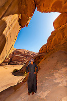Bedouin boy, Burdah Rock Bridge, Arabian Desert, Wadi Rum, Jordan.