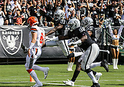 Sep 30, 2018; Oakland, CA, USA;  Oakland cornerback Gareon Conley (21) score on a 36 yard interception return in the first quarter of a game between the Oakland Raiders and the Cleveland Browns. The Raiders defeated the Browns 45-42 in overtime. Mandatory Credit: Spencer Allen-Image of Sport