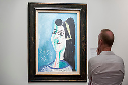 "© Licensed to London News Pictures. 28/06/2018. LONDON, UK. A visitor views ""Tête De Femme"", 1963, by Pablo Picasso. Members of the public visit Masterpiece London, the world's leading cross-collecting art fair held in the grounds of the Royal Hospital Chelsea.  The fair brings together 160 international exhibitors presenting works from antiquity to the present day and runs 28 June to 4 July 2018.  Photo credit: Stephen Chung/LNP"