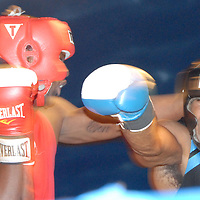 Amateur Heavyweights Dakota Walker (left) and Mingo Brown box during ``Big Fighters, Big Cause'' charity boxing event at the Santa Monica Pier on Tuesday, May 25, 2010. Walker won the bout by decision.