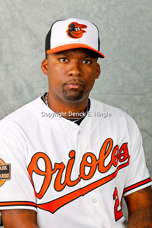 March 1, 2012; Sarasota, FL, USA; Baltimore Orioles third baseman Wilson Betemit (24) poses for a portrait during photo day at the spring training headquarters.  Mandatory Credit: Derick E. Hingle-US PRESSWIRE