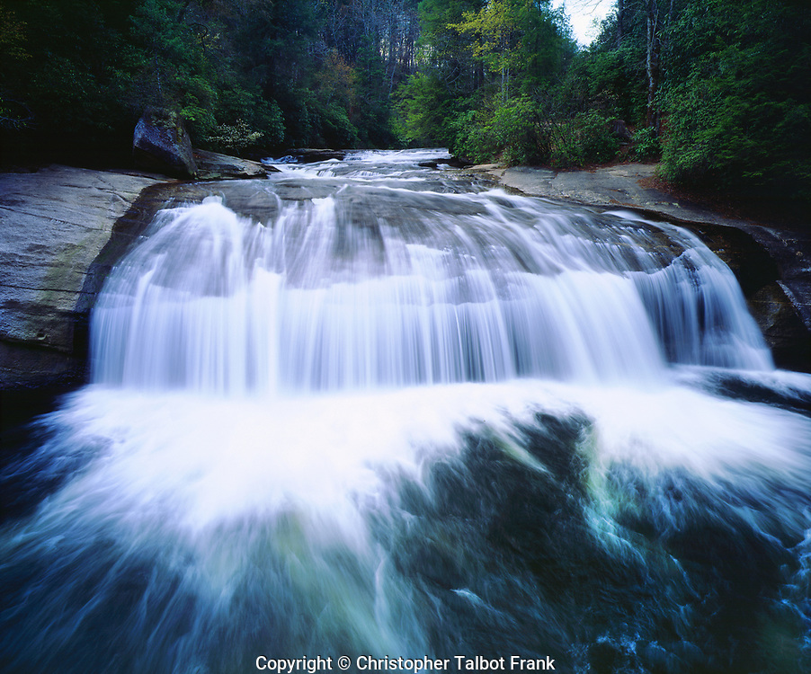 I photographed this popular North Carolina destination that is seen in my photo of the blue green Turtleback Falls in Nantahala National Forest. This beautiful river drops from the lush green forest showing the flowing motion of the wide waterfall.