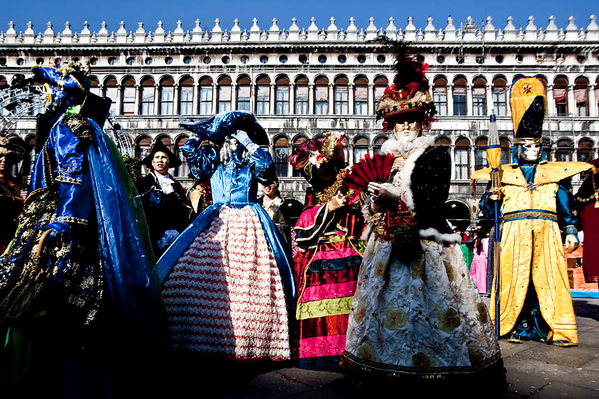 Masked revellers pose in Saint Mark Square during the  Venetian Carnival in Venice.