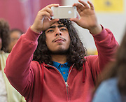 A Furr High School student captures the action during a stop of the Listen & Learn tour at Marshall Elementary School, September 20, 2016.