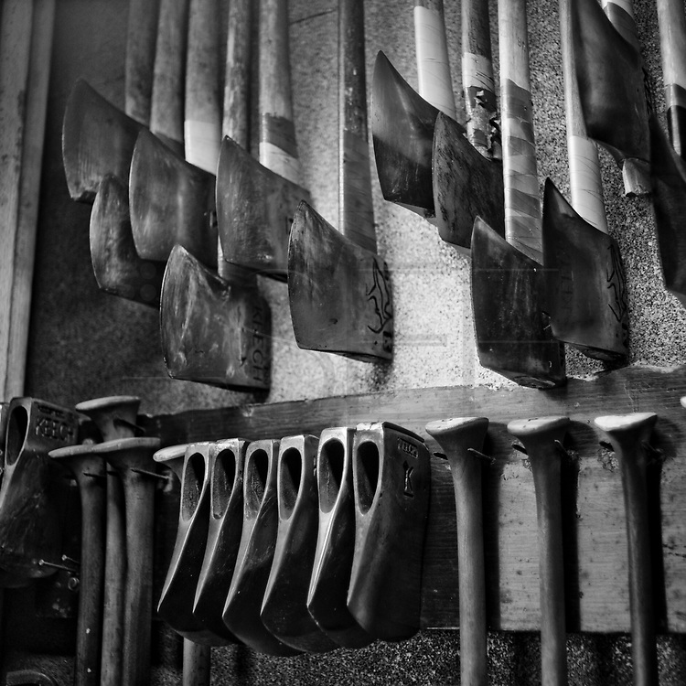 """Ernesto Ezpeleta """"Bihurri"""", wood cutter or aizkolari in Basque language. Axes at  his home in Mendaro. Basque rural sports (Herri Kirolak in basque language) are rooted in traditional lifestyles, mostly farmer occupations of the Basque Country, in Northern Spain. Nowadays they have transform themselves into sports based in strenght and skill. Stone lifting and wood chopping are the most popular."""