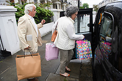 © Licensed to London News Pictures. 01/06/2016. London, UK. COLIN and ALISON HUMPHREYS, the father-in-law and mother-in-law of Ronnie Wood, leave the Rolling Stones guitarist's London home holding gifts two days after Ronnie Wood and his wife Sally Humphreys had twins. Ronnie Wood also turned 69 today (weds).  Photo credit: Ben Cawthra/LNP