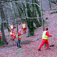 Comrie Missing man...6.12.99.(File Pic).<br />Members of the Tayside Police Search and Rescue Unit<br />searching the Glen Lednock and Deil's Caldron area of woodland and hillside at the edge of Comrie, Perthshire.<br /><br />Picture Copyright John Lindsay.<br />Perthshire Picture Agency<br />Tel: 01738 623350  Mobile: 07775 852112