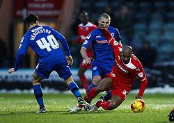 Rochdale's Ian Henderson challenges Crawley Town's Marvin Elliott - Photo mandatory by-line: Matt McNulty/JMP - Mobile: 07966 386802 - 17.01.2015 - SPORT - Football - Rochdale - Spotland Stadium - Rochdale v Crawley Town - Sky Bet League One
