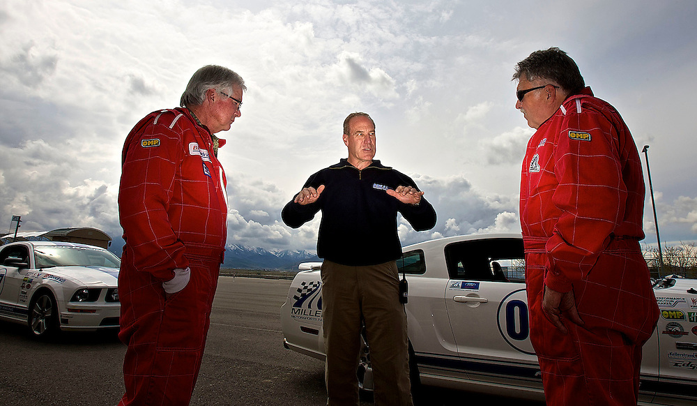 Driving instructor Charlie Putnam of Casper, Wyo. talks to Greg Lynch, left of Breckenridge, Colorado and Bob Johnson, right of Tooele as they attend a high performance driving class at Miller Motorsports park driving school in Tooele, Utah, Thursday, May 13, 2010 . Students who finish the course have a better understanding of how a car reacts on wet or icy pavement and how to a safer driver. August Miller, Deseret News .