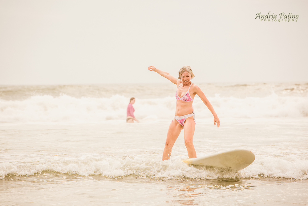 Woman learning to surf, Santa Teresa, Costa Rica