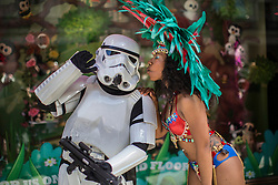 © licensed to London News Pictures. London, UK 12/05/2013. A dancer with a carnival dress who represents Trinidad and Tobago at The World on Regent Street event, kissing a Stormtropper outside Hamleys in London on Sunday, 12 May 2013. Many countries showcase the best of each country's culture, music and dance, art, food and fashion to Londoners on Regent Street. Photo credit: Tolga Akmen/LNP