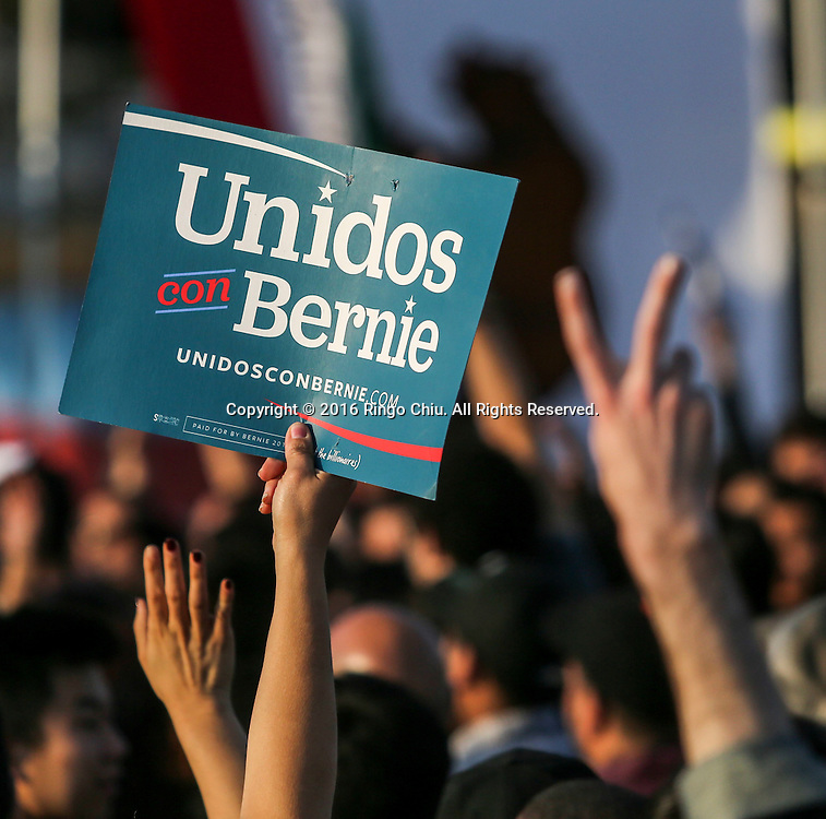 Democratic presidential candidate Bernie Sanders supporters hold up signs during a rally at Ganesha High School Stadium in Pomona Calif., on May 26, 2016.(Photo by Ringo Chiu/PHOTOFORMULA.com)<br /> <br /> Usage Notes: This content is intended for editorial use only. For other uses, additional clearances may be required.
