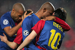 Lionel Messi and Samuel Eto'o embrace after Lionel Messi scores (foreground) and Thierry Henry and Iniesta replicate their embrace (rear) during the UEFA Champions League quarter final first leg match between FC Barcelona and FC Bayern Munich at the Camp Nou stadium on April 8, 2009 in Barcelona, Spain.