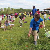 Older children scramble for Easter eggs at the Junior Women's League's community event April 6 at Blue Bluff. In addition to egg hunts in four different sections for different age groups, there were inflatable bouncers, a DJ and visits with the Easter bunny. Mothers of Vision also helped in the event, which had several community sponsors. Nearly 300 people people attended with nearly 200 children participating.