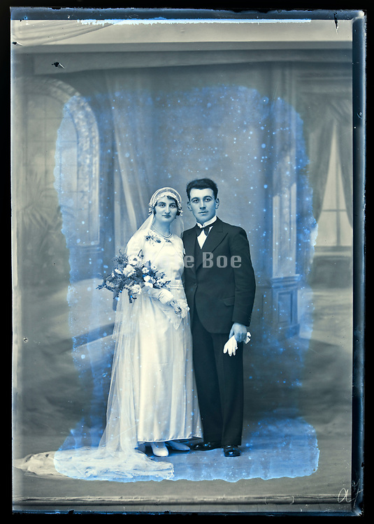 deteriorating wedding portrait in studio with classic interior background France circa 1930s