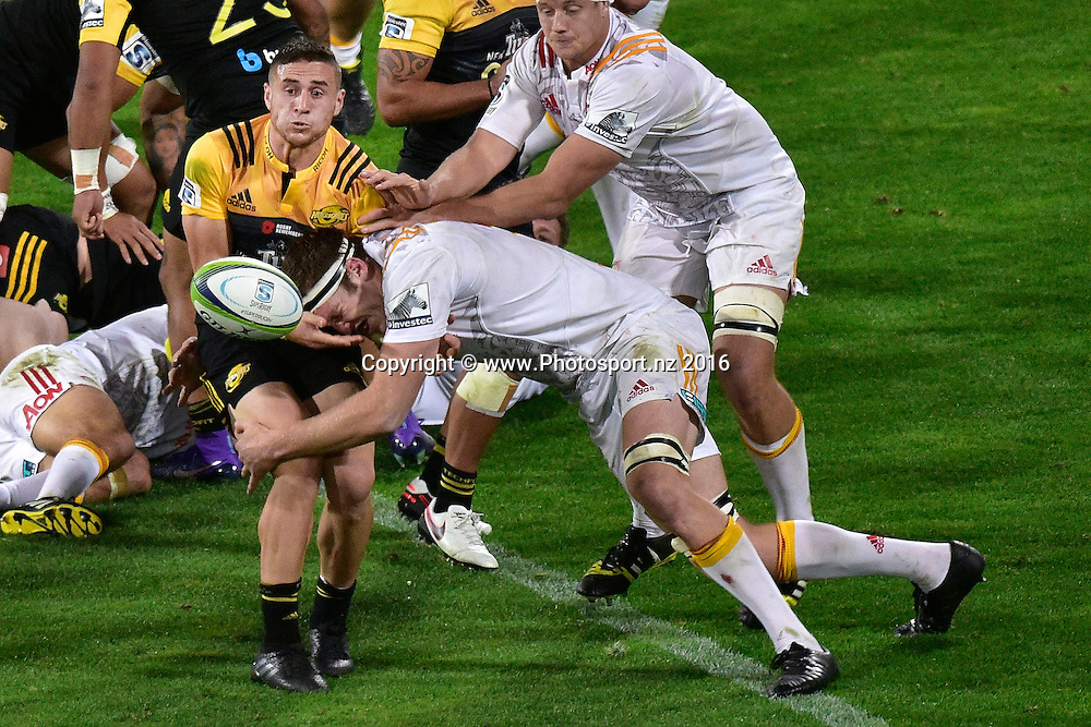 Hurricanes' TJ Perenara (L) is tackled by Chiefs' Captain Sam Cane during the Hurricanes vs Chiefs Super Rugby match at the Westpac Stadium in Wellington on Saturday the 23rd of April 2016. Copyright Photo by Marty Melville / www.Photosport.nz