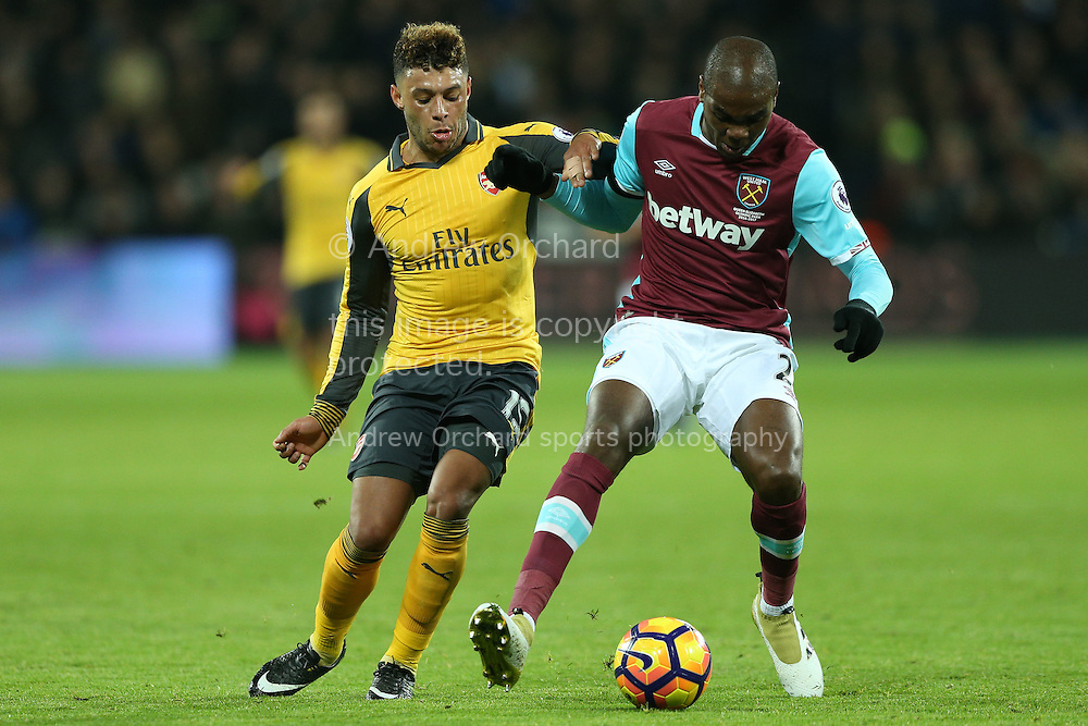 Alex Oxlade-Chamberlain of Arsenal intercepts Alvaro Arbeloa of West Ham United. Premier league match, West Ham Utd v Arsenal at the London Stadium, Queen Elizabeth Olympic Park in London on Saturday 3rd December 2016.<br /> pic by John Patrick Fletcher, Andrew Orchard sports photography.