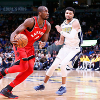 01 November 2017: Toronto Raptors forward Serge Ibaka (9) drives past Denver Nuggets guard Jamal Murray (27) during the Denver Nuggets 129-111 victory over the Toronto Raptors, at the Pepsi Center, Denver, Colorado, USA.