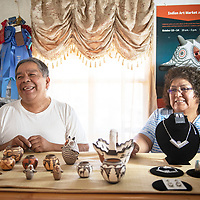 Zuni artists Carlos Laate, left, a Zuni Pueblo potter and his wife Roxanne Seoutewa, a Zuni Pueblo Petti-point silversmith pictured with their art in their home studio Thursday, July 4 in Zuni.