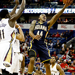 Dec 15, 2016; New Orleans, LA, USA; Indiana Pacers guard Jeff Teague (44) shoots over New Orleans Pelicans forward Anthony Davis (23) and guard Jrue Holiday (11) and guard Langston Galloway (10) during the second quarter of a game at the Smoothie King Center. Mandatory Credit: Derick E. Hingle-USA TODAY Sports
