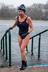 © Licensed to London News Pictures. 26/02/2018. London, UK. A member of the Serpentine Swimming Club braves the 2°C water of the Serpentine in Hyde Park as snow falls. Severe cold, blizzards and heavy snow are expected as the 'Beast from the East' brings freezing Siberian air to the UK. Photo credit: Rob Pinney/LNP