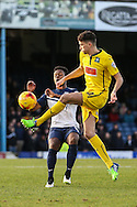 Shaquile Coulthirst of Southend is beaten to the ball by Tom Flanagan of Plymouth Argyle, currently on load from MK Dons,  during the Sky Bet League 2 match at Roots Hall, Southend<br /> Picture by David Horn/Focus Images Ltd +44 7545 970036<br /> 10/01/2015