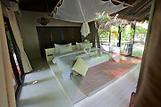 Thailand, Ko Kradan. The Sevenseas Resort. A Deluxe Bungalow bedroom.
