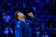 Warsaw, Poland - 2017 April 20: Adrian Gomboc from Slovenia (blue) celebrates after victory while the men&rsquo;s 66kg semifinal during European Judo Championships 2017 at Torwar Hall on April 20, 2017 in Warsaw, Poland.<br /> <br /> Mandatory credit:<br /> Photo by &copy; Adam Nurkiewicz / Mediasport<br /> <br /> Adam Nurkiewicz declares that he has no rights to the image of people at the photographs of his authorship.<br /> <br /> Picture also available in RAW (NEF) or TIFF format on special request.<br /> <br /> Any editorial, commercial or promotional use requires written permission from the author of image.