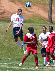 Virginia Cavaliers defender Shawn Barry (21).  The North Carolina State Wolfpack defeated the Virginia Cavaliers 1-0 in NCAA Men's Soccer during a spring scrimmage at the Klockner Stadium practice field on the Grounds of the University of Virginia in Charlottesville, VA on April 4, 2009.