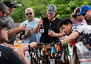 23 JUNE 2018 -- MAPLEWOOD, Mo. -- Beer aficionados sample micro brews while waiting in line in the parking lot at Side Project Brewing in Maplewood for the release of the brewery's Raspe Red Raspberry Missouri Wild Ale Saturday, June 23, 2018. The release of the ale drew beer drinkers from as far away as Houston. Photo © copyright 2018 Sid Hastings.