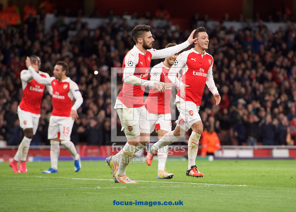 Mesut Ozil of Arsenal (right) celebrates after heading the ball past goalkeeper Eduardo of Dinamo Zagreb to score the opening goal with Olivier Giroud of Arsenal during the UEFA Champions League match at the Emirates Stadium, London<br /> Picture by Alan Stanford/Focus Images Ltd +44 7915 056117<br /> 24/11/2015