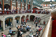 England, London: singer sings in Convent Garden market England, London: