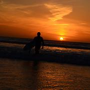 Surfer in sunset