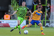 Forest Green Rovers Carl Winchester(7) passes the ball forward during the EFL Sky Bet League 2 match between Forest Green Rovers and Mansfield Town at the New Lawn, Forest Green, United Kingdom on 19 October 2019.