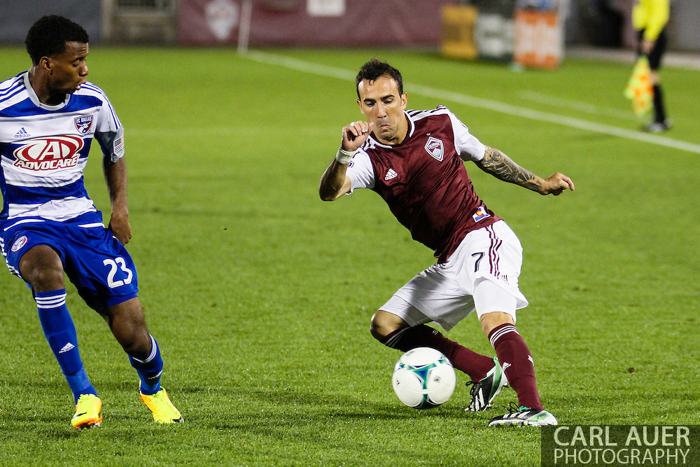 September 14th, 2013 -  Colorado Rapids forward Vicente Sánchez (7) attempts to get past FC Dallas midfielder Kellyn Acosta (23) in the first half of action in the MLS Soccer game between FC Dallas and the Colorado Rapids at Dick's Sporting Goods Park in Commerce City, CO