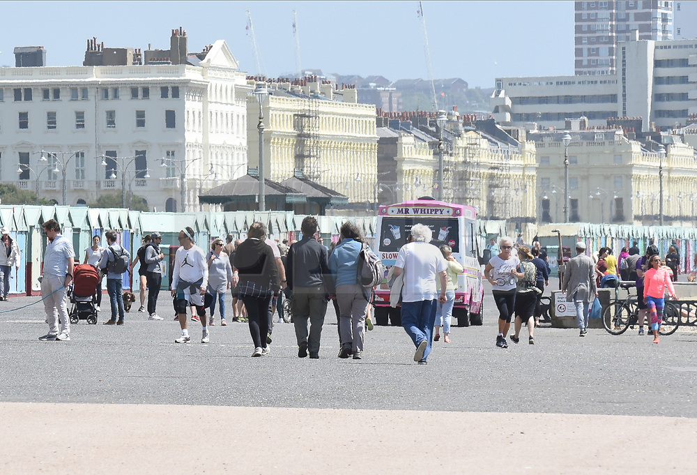 © Licensed to London News Pictures. 24/05/2020. Brighton, UK. Members of the public relax in the hot weather on Brighton seafront in East Sussex, during lockdown to prevent to spread of COVID-19.  Photo credit: Liz Pearce/LNP