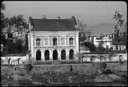 Nepal. Kathmandu valley. Small colonial style building on the banks of the Vishnumathi river that runs through the valley.<br /> Copyright: Dominic Sansoni