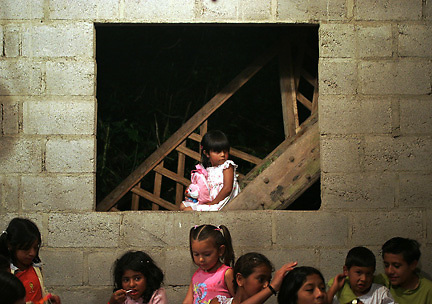5 year-old Estefani Del Hierro sits on the stairs in her house observing her neighborhood friends playing at her birthday party.