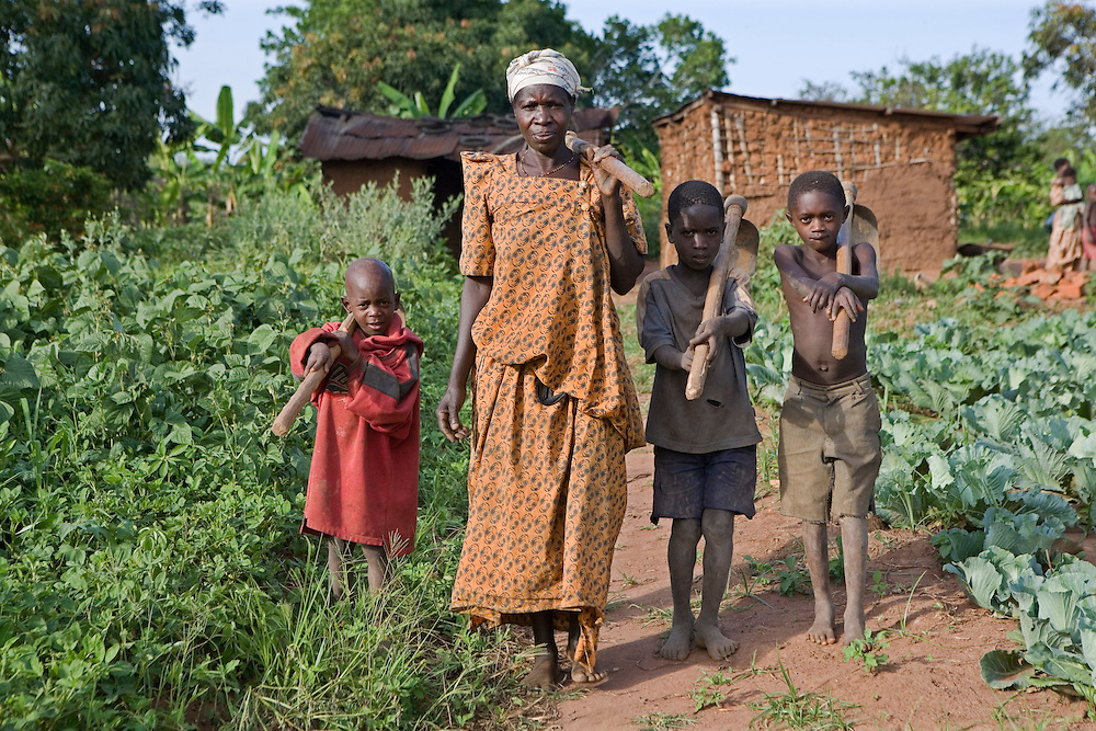 Madam Edith Kizito and three of her children farm her crops. Kulika trained Edith in 2005 and since then her production and quality of crops has increased dramatically. She is the chairperson of the Ziunula group, one of seven groups trained by Kulika in the Nakasongolo district of Uganda.