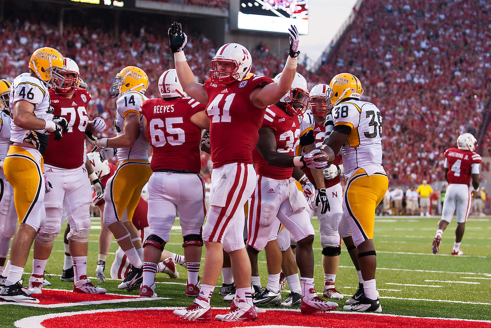 September 7, 2013: Jake Long #41 of the Nebraska Cornhuskers celebrates a touchdown by Imani Cross #32 in the fourth quarter against the Southern Miss Golden Eagles at Memorial Stadium in Lincoln, Nebraska.