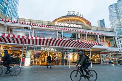 Superdry clothing store inside Kranzler building  on famous Kurfurstendamm shopping street in Berlin, Germany.