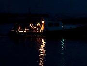Fishing boat before dawn going out to sea from Captree, Fire Island