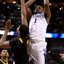 Mar 19, 2011; Tampa, FL, USA; Kentucky Wildcats guard Darius Miller (1) shoots over West Virginia Mountaineers forward Kevin Jones (5) during the second half of the third round of the 2011 NCAA men's basketball tournament at the St. Pete Times Forum. Kentucky defeated West Virginia 71-64.  Mandatory Credit: Derick E. Hingle