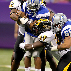 Dec 20, 2009; New Orleans, LA, USA; Southern Miss Golden Eagles linebacker Korey Williams (42) and defensive tackle Terrance Conner (29) tackle Middle Tennessee State Blue Raiders quarterback Dwight Dasher (9) during the first half of the 2009 New Orleans Bowl at the Louisiana Superdome.  Mandatory Credit: Derick E. Hingle-US PRESSWIRE