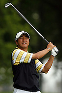 Keiichiro Fukabori of Japan hitss his tee chot on the thirteenth hole during the first day of the US Open Golf Championship at Winged Foot Golf Club in Mamaroneck, New York Thursday, 15 June 2006.