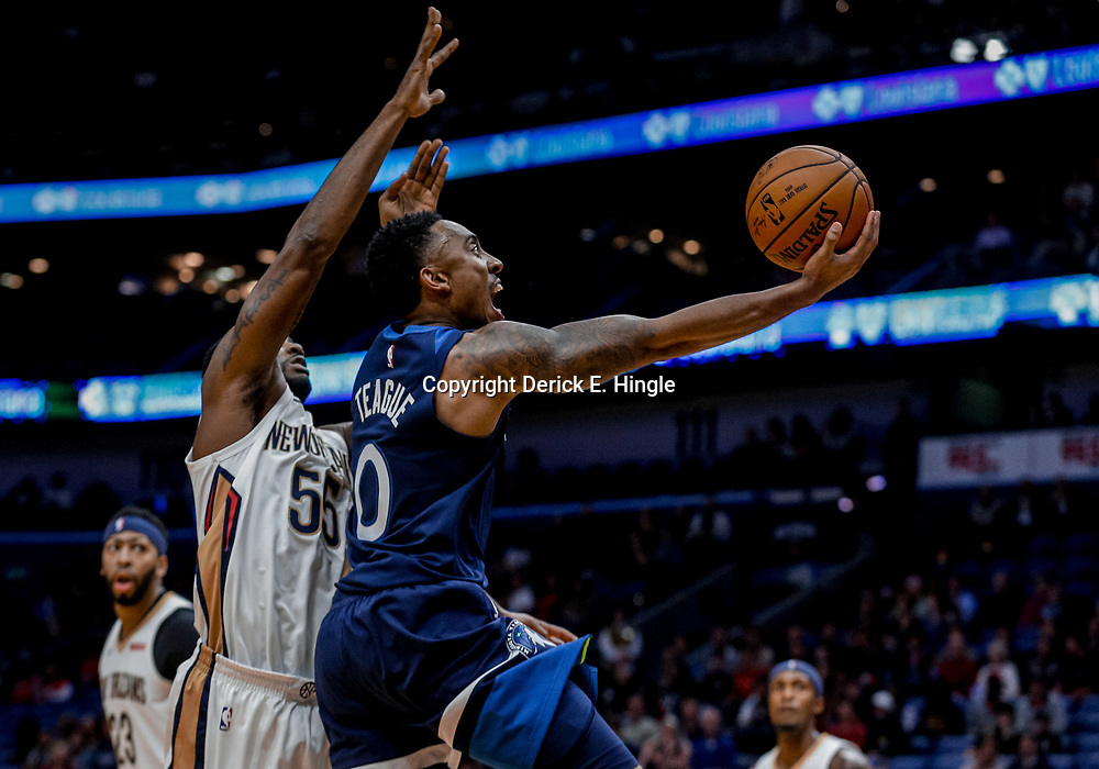Nov 1, 2017; New Orleans, LA, USA; Minnesota Timberwolves guard Jeff Teague (0) shoots over New Orleans Pelicans guard E'Twaun Moore (55) during the first quarter of a game at the Smoothie King Center. Mandatory Credit: Derick E. Hingle-USA TODAY Sports