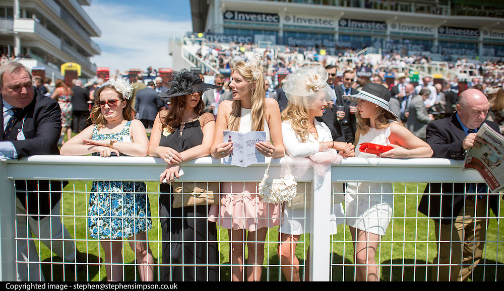 © Licensed to London News Pictures. 06/06/2014. Epsom, UK. A group of women loose on their horse in The Princess Elizabeth Stakes. Ladies Day today 6th June 2014 at Epsom 2014 Investic Derby Festival in Surrey. Traditionally, elegant, fashionable racegoers gather for a classic day's racing at Epsom Racecourse, Surrey. Photo credit : Stephen Simpson/LNP