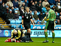 Photo: Ed Godden/Sportsbeat Images.<br />Coventry City v Cardiff City. Coca Cola Championship. 10/02/2007. Cardiff's Michael Chopra receives medical attention.
