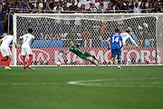 England Forward Wayne Rooney puts the ball to the keepers right during the Round of 16 Euro 2016 match between England and Iceland at Stade de Nice, Nice, France on 27 June 2016. Photo by Andy Walter.